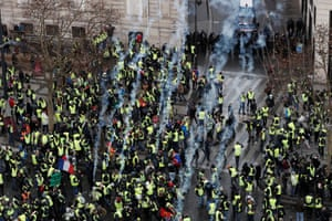 Teargas is launched at protesters wearing yellow vests during clashes with French gendarmes on the Champs Élysées