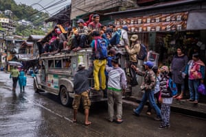 In earlier days it was quite common to ride on the roof of a jeepney
