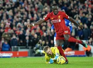 Sadio Mane of Liverpool goes round Everton goalkeeper Jordan Pickford.