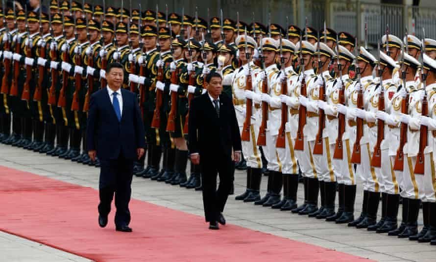 Rodrigo Duterte and Xi Jinping review the honour guard during the welcome ceremony at the Great Hall of the People in Beijing, China.