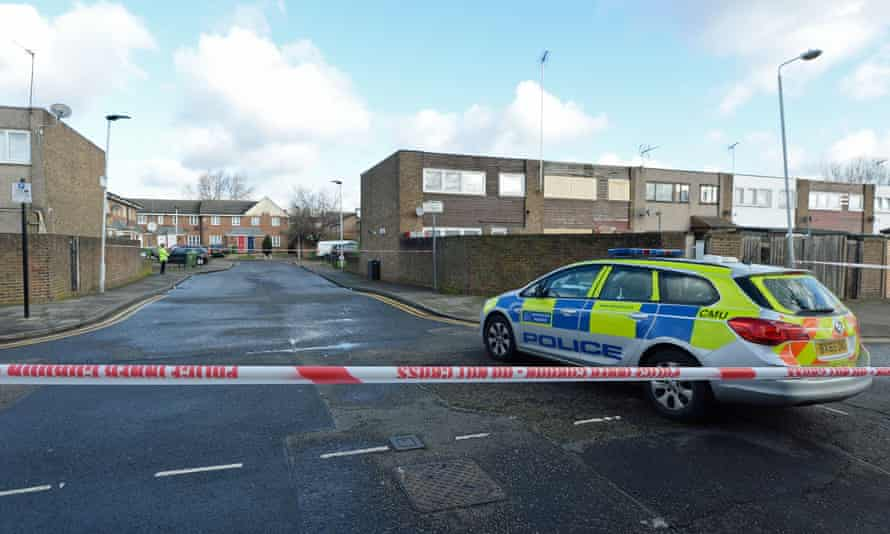 Police close to the scene in Goldwing Close, Canning Town, east London, where the boy was stabbed.