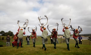 The Abbots Bromley horn dance. The dance comprising of six Deer-men, a Fool, Hobby Horse, Bowman and Maid Marian start in the early morning at the village church. A melodian player accompanies the dancers as they parade around the parish holding Reindeer antlers above their heads. The traditional Wakes Monday dance is believed to be the oldest folk dance in Britain and some of the antlers have been carbon dated to be over 1000 years old.