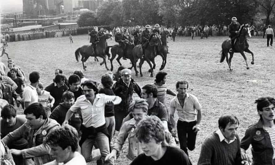 Striking miners flee a charge by mounted police at Orgreave coking works in south Yorkshire in 1984.