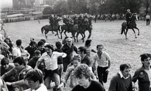 Striking miners run away from mounted police officers at Orgreave