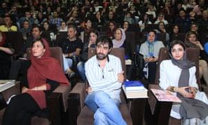 Mahtab Keramati, left, and Shahab Hosseini, centre, at a campaign event in Tehran.