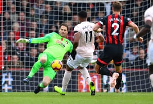 Anthony Martial is beaten to the ball by Asmir Begovic.