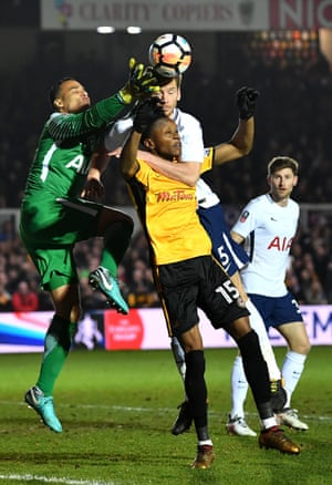 Shawn McCoulsky of Newport County competes for a header with Michel Vorm and Jan Vertonghen of Tottenham Hotspur during the 1-1 draw at Rodney Parade setting up a reply back at Wembley.