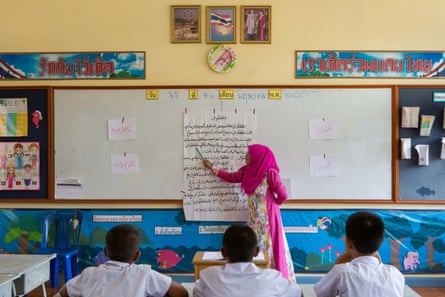At Banbuengnamsai primary school, which signed up to a pilot programme to integrate Patani-Malay languages in schools, a teacher gives an Arabic lesson.