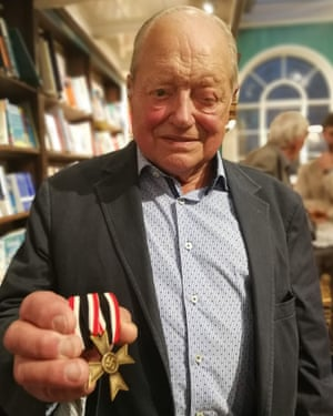 Ernest Kohout with the Nazi medal, faked by a Jewish bank, which he discovered after the death of his father Hans.
