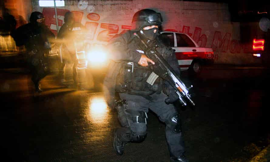 A state police officer during a confrontation with members of a gang in the neighbourhood of Casa Blanca in Xalapa in Veracruz state.