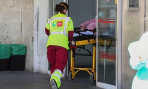 A patient is wheeled into the emergency unit at Madrid's 12 de Octubre hospital.