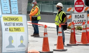 Construction workers wear their face mask in Downtown Miami, Florida, in July in accordance with local regulations. The state governor, Ron DeSantis, resisted calls for a statewide mask mandate.
