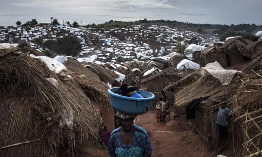 A Congolese woman walks through a camp for internally displaced people in Kalemie, in the DRC's Tanganyika province, where conflict displaced 650,000 people at one point.