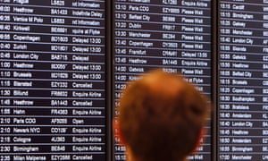 Man views an airline departures board