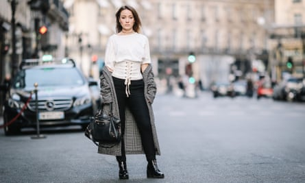 A street style star in a Zara corset top during Paris fashion week, January 2017.