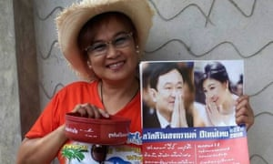 Theerawan Charoensuk, who has been charged with sedition in Thailand because the bowl she is holding bears a greeting from the former prime minister, Thaksin Shinawatra.