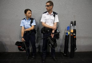 Hong Kong police officers wear riot gear ahead of the announcement of the results of Hong Kong's legislative council elections on Monday.