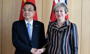China's prime minister Li Keqiang poses with Theresa May at the Asia-Europe summit in Brussels today.