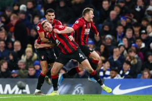 Dan Gosling of Bournemouth celebrates with teammates Dominic Solanke and Ryan Fraser as Bournemouth score late to beat Chelsea at Stamford Bridge.