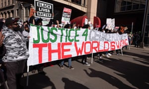 Protesters march in Minneapolis to demand justice for George Floyd on the first day of Derek Chauvin's trial yesterday.