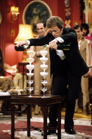 Pouring champagne into glasses balanced on top of each other, 1983