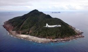 A Japanese maritime self-defence force plane flying over the Senkaku islands