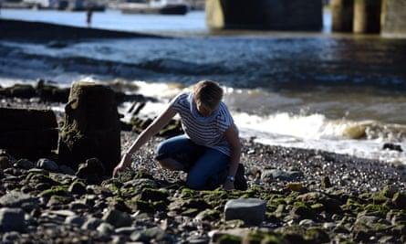Lara mudlarking on the foreshore