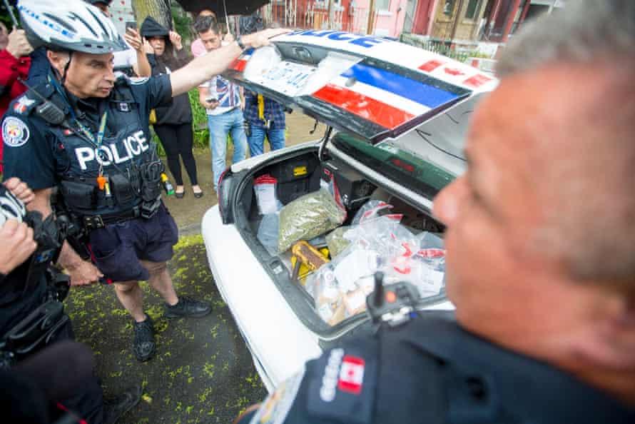 Police seize marijuana from a dispensary in Toronto.