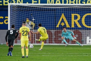 Villarreal's Gerard Moreno scores their first goal from the penalty spot.