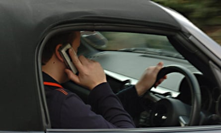 Mobile phone use by driversPOSED BY MODEL Undated file photo of a man using his mobile phone while driving. A driving instructor supervising a pupil was among 261 people caught illegally using a mobile phone after tougher penalties were introduced. PRESS ASSOCIATION Photo. Issue date: Wednesday March 15, 2017. Another man was spotted doing his online banking while driving along the M5 motorway near Birmingham in a series of stops carried out by West Midlands Police earlier this month. See PA story POLICE Mobile. Photo credit should read: Barry Batchelor/PA Wire