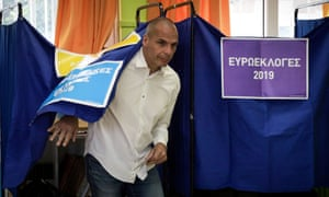 Varoufakis leaves a voting booth in Athens.