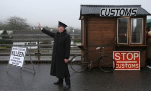 A mock customs post set up at the Irish border in County Louth by anti-Brexit campaigners in the monhs fater the Brexit vote. The return of customs posts or any border infrastructure would underline the reason for resistance, McKenna said.