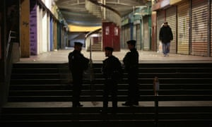 Police stand guard in the Rose-des-Vents district also known as the 3,000 estate in Aulnay-sous-Bois.