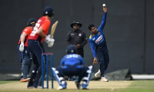 Kamindu Mendis bowls left-arm spin to Joe Root during England's warm-up match against a Sri Lanka Cricket Board XI in Colombo. The 20-year-old also bowled right-arm spin during the contest