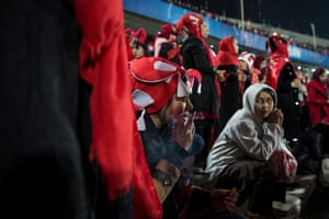 A woman smokes during the final match of the AFC Champions League between Iran's Perspolis and Japan's Kashima Antlers in Tehran.