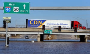 Roads remained submerged in Missouri on Saturday after the Mississippi burst its banks.