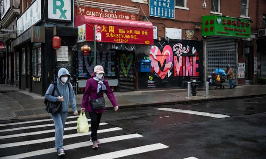 Pedestrians wearing face masks walk across a street in New York. Koa has said she safer wearing a mask in public.
