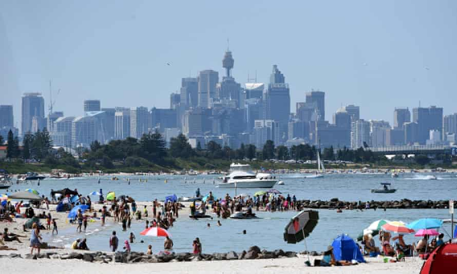 Beach goers at Brighton-Le-Sands in Sydney's southern suburbs seeking respite from the heat.