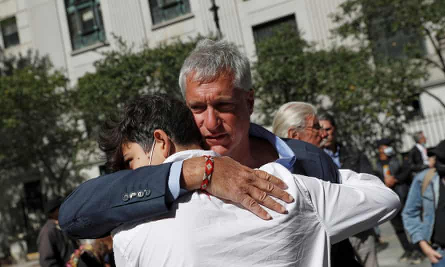 Attorney Steven Donziger, who was sentenced on Friday for criminal contempt stemming from his decades-long legal battle with Chevron Corp, embraces his son Matthew after his hearing in Manhattan.
