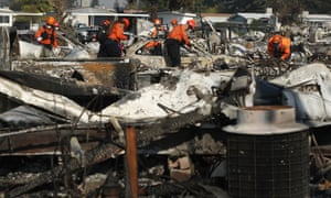 Members of a search and rescue team search through the rubble of mobile homes in Santa Rosa.