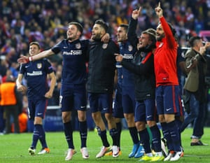 Atlético Madrid players celebrate after the match.