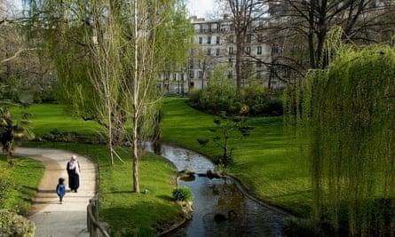 Visitors stroll through the Square des Batignolles, Paris.