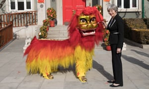 Theresa May with the lion