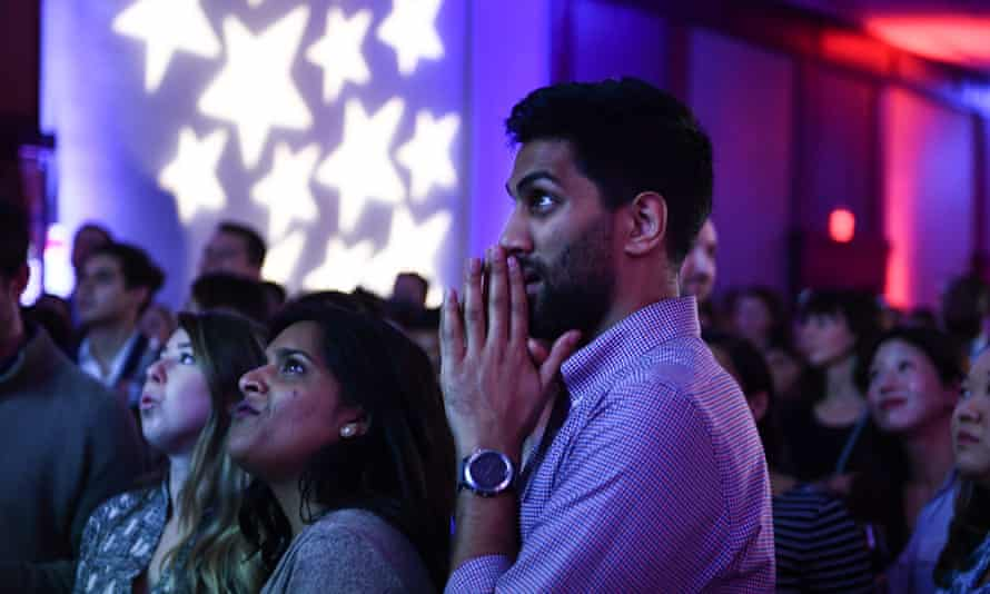 US-POLITICS-ELECTION-VOTE<br>People react to live results while attending a midterm election night party hosted by the Democratic Congressional Campaign Committee November 6, 2018 in Washington, DC. (Photo by Brendan Smialowski / AFP)BRENDAN SMIALOWSKI/AFP/Getty Images