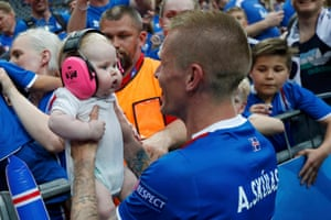 Whilst Ari Freyr Skúlason celebrates with a (very) young fan.