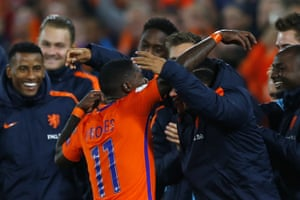 The Dutch substitutes hug Quincey Promes after he scored.