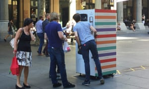 People line up at the Intangible Goods vending machine art installation in Sydney's Martin Place.