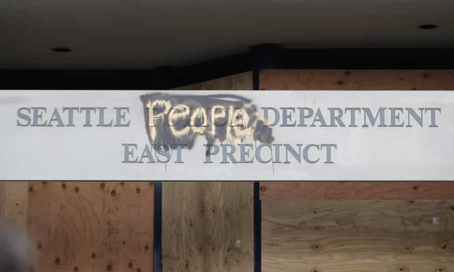 A modified sign for the Seattle police department's east precinct building.