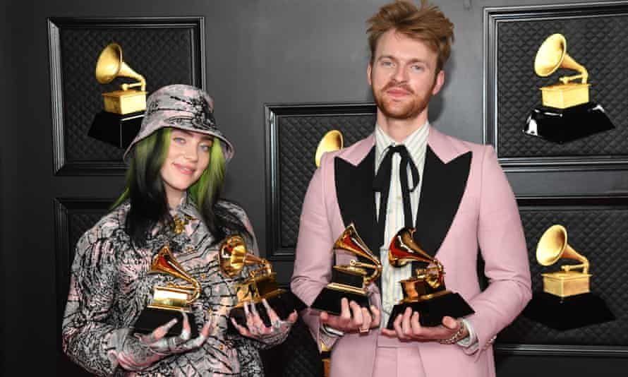 """Billie Eilish and FINNEAS, winners of Record of the Year for 'Everything I Wanted' and Best Song Written For Visual Media for """"No Time To Die"""", pose in the media room during the 63rd Annual GRAMMY Awards at Los Angeles Convention Center on March 14, 2021 in Los Angeles, California"""