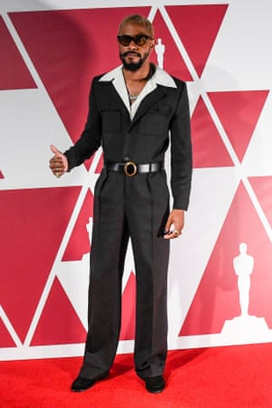 Woah so Lakeith Stanfield is in custom-made Saint Laurent by Anthony Vaccarello. Where to start? The Safar-style jacket, the nipped-in waist, the flared trousers, the girth of those lapels. It is loosely based on a women's look by the same brand. What woman wouldn't want to wear that?